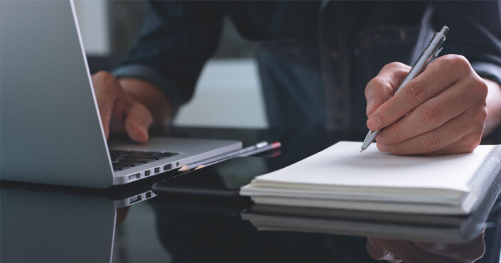 Businessman writing note